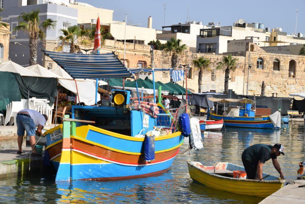 Traditional luzzu boats in the harbour at Marsaslokk, Malta