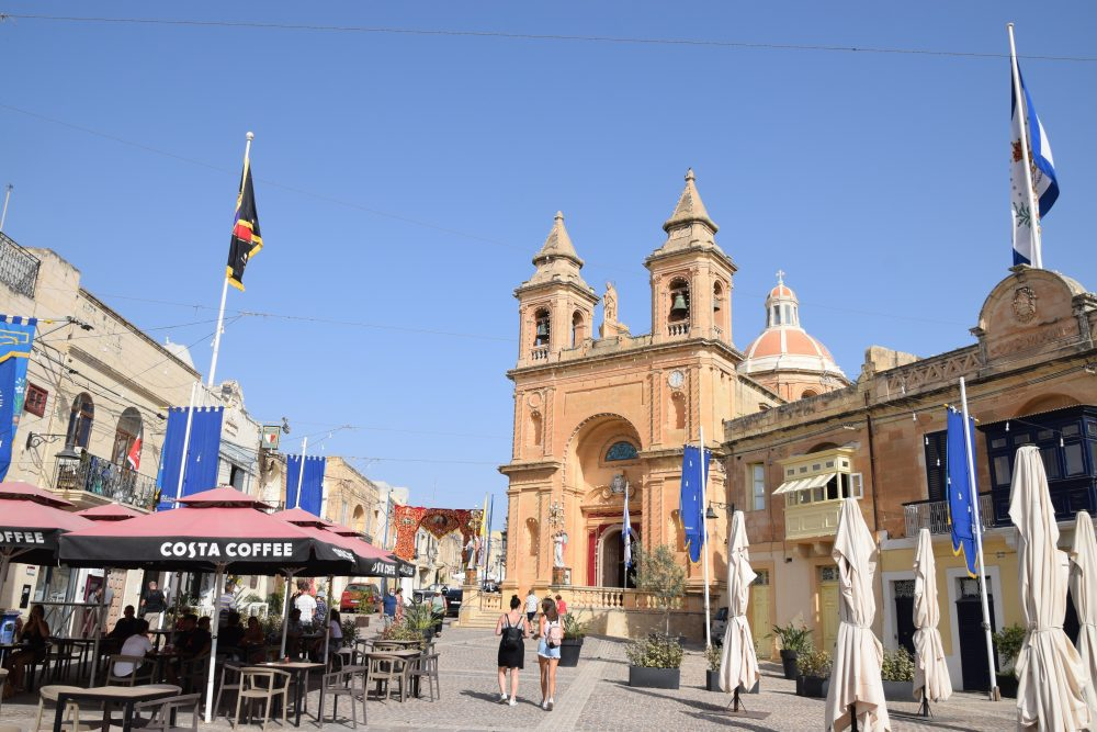 A front view of the church dedicated to the Madonna of Pompeii. and the square which it sits, Marsaslokk