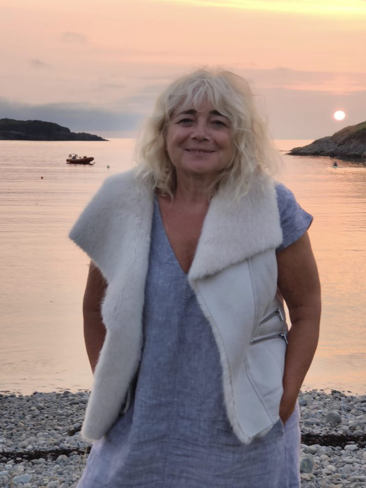 A portrait of Sue on the beach at Scourie, Scotland at sunset