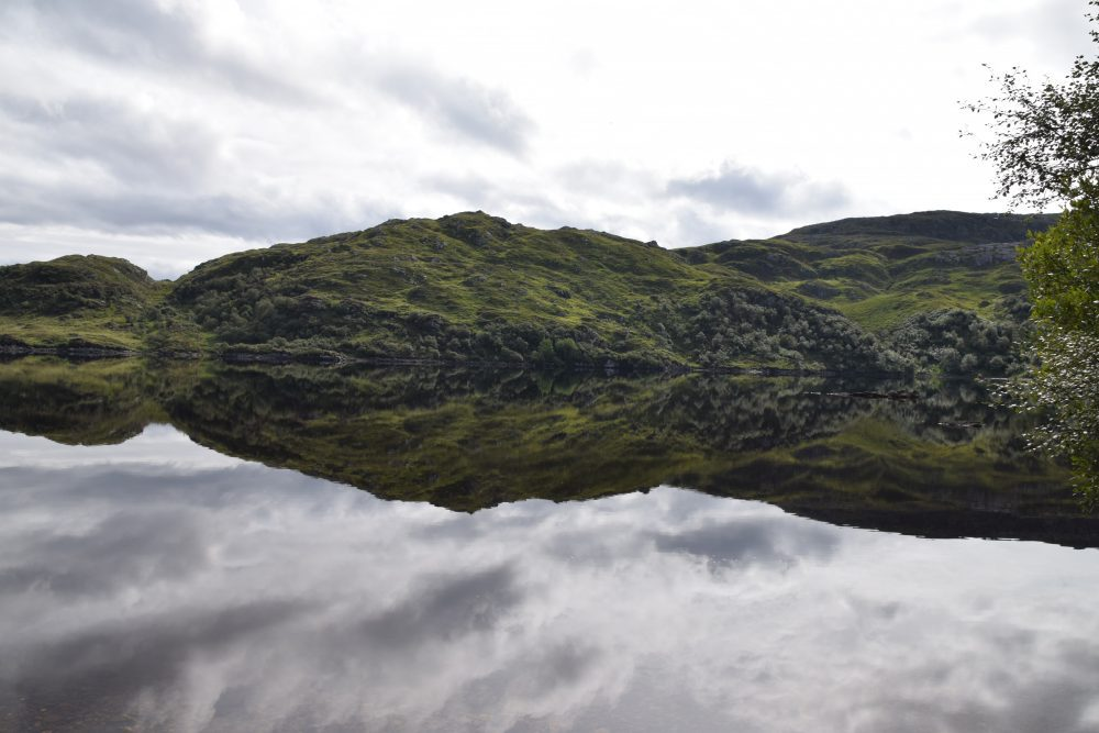 Hills and clouds reflected in a loch, north west Scotland