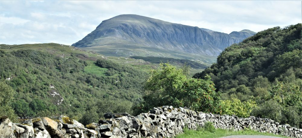Stark mountain slopes in northwest Scotland a drystone wall in the foreground