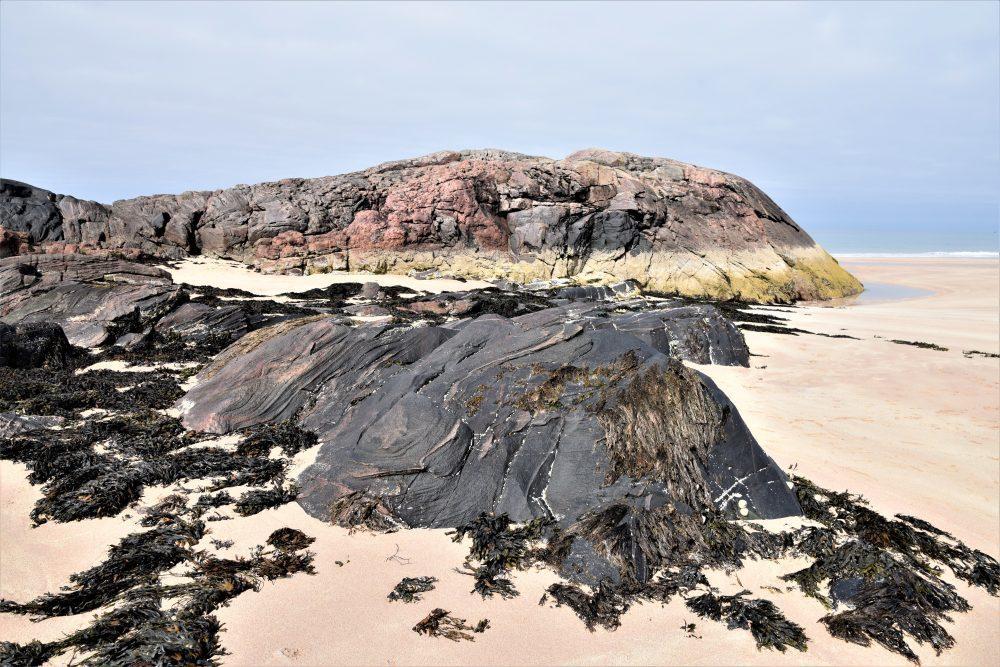 Striped rock formations on Sandwood Bay Beach, Scotland