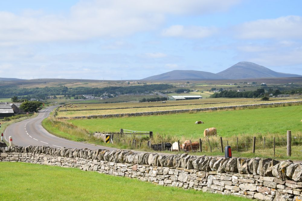 Rural scene framed by mountains in north east Scotland