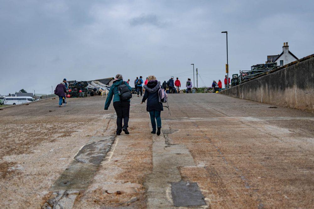 Sue walking up the slipway at Iona