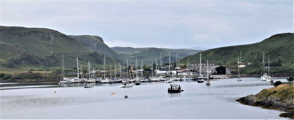 Boats in the harbour at Kerrera, framed by rolling hills