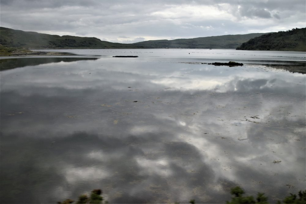 Clouds reflected on a loch in Mull