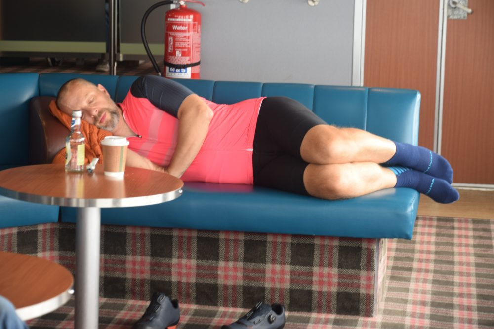 A sleeping cyclist on the ferry to Barra in the Western Isles