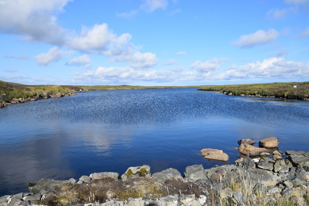 Clouds reflected in a gloriously blue lochan on Lewis